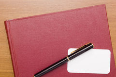 名片的红色书 库存照片