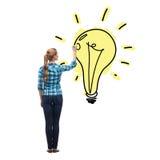 从后面图画电灯泡的妇女在天空中 免版税库存图片
