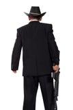 黑后面射击的照片的枪手在白色 免版税库存图片