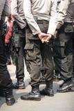 从后面的身体部分的印度尼西亚警察 免版税库存照片