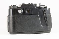 后面看法,如果在白色背景的老影片SLR照相机 免版税库存图片