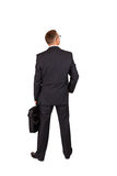 后面观点的与笔记本袋子的一个商人 免版税库存照片