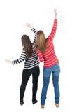 后面观点的二个年轻人深色的常设妇女 免版税图库摄影