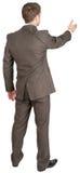 后面观点的在握手的衣服的商人 免版税库存照片