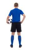 后面观点的在白色隔绝的蓝色制服的足球运动员 库存图片