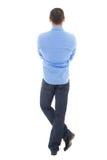后面观点的在白色隔绝的蓝色衬衣的商人 库存图片