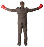 后面观点的在红色拳击手套的商人 库存照片