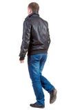 后面观点的夹克的去的英俊的人 免版税库存照片