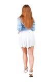后面观点的礼服的连续妇女 免版税图库摄影