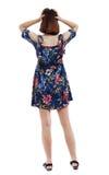 后面观点的礼服的震惊妇女 免版税图库摄影