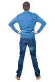 后面观点的蓝色套头衫的英俊的人 免版税库存照片