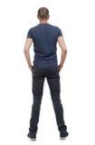 后面观点的长裤的人 库存图片