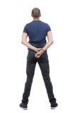 后面观点的长裤的人 库存照片