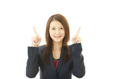向上指向年轻的女商人 免版税库存照片
