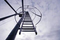 向上移动的梯子 库存图片