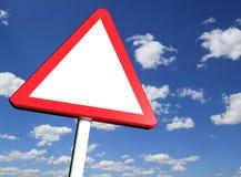 向前警告空白的危险路标 免版税库存照片