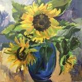 向日葵图画在一个蓝色花瓶的 免版税库存图片