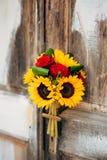 向日葵婚姻的新娘花束在白色的背景的  库存图片