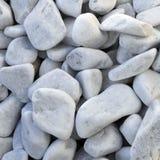 向白色扔石头 库存图片