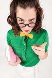 向讨厌的女孩某人透露 免版税库存照片