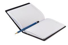 否决在黑皮革宴鼠皮笔记本 免版税图库摄影