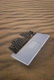 含沙的笔记本 免版税库存图片