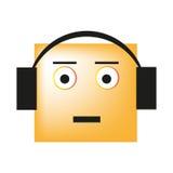 听到在耳机的音乐的面带笑容和享受歌曲 库存图片
