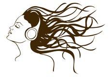 听到音乐的女孩画象 库存图片