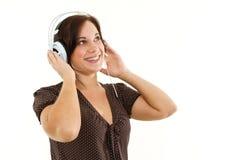听到音乐的妇女 库存图片