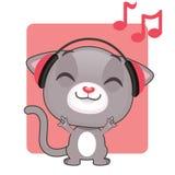 听到音乐的逗人喜爱的灰色小猫 库存图片