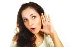听的女孩某事惊奇了 免版税库存照片