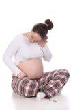 听的孕妇 图库摄影