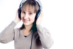 听的音乐妇女 图库摄影