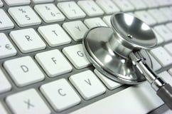 听诊器。键盘 库存图片