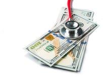 听诊器和一百元钞票 库存图片