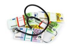 听诊器和货币 免版税库存图片