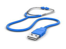 听诊器和USB缆绳 库存图片