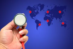 听诊器拯救世界 图库摄影