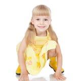 启动愉快的女孩一点黄色 免版税库存图片