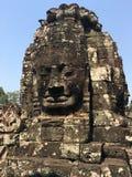 吴哥窟在暹粒市,柬埔寨吴哥窟是复杂最大的印度寺庙和最大的宗教纪念碑在世界上 石面孔在Bayon高棉寺庙古老废墟雕刻了  免版税图库摄影