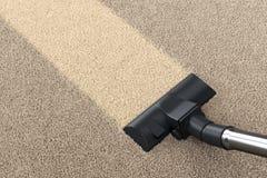 吸尘器和地毯 图库摄影