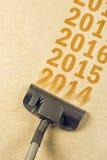 吸尘器详尽的年从地毯的第2014年 免版税库存照片
