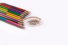 吸引与多彩多姿的木头的一只眼睛 免版税图库摄影