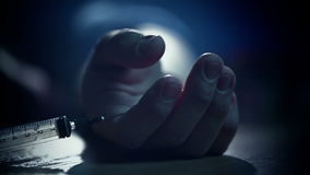image photo : Junkie hand Fall to floor pricked heroin or meth