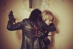 吸血鬼和她的受害者 图库摄影