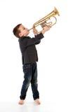 吹入喇叭的男孩 库存图片