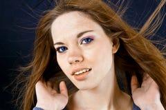 吹动女孩头发 免版税库存图片