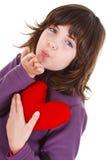 吹动逗人喜爱的女孩亲吻 免版税库存照片