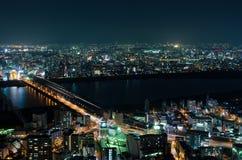 吹田和Toyonaka地平线在晚上 免版税库存图片