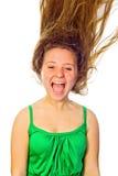吹的头发妇女 免版税库存图片